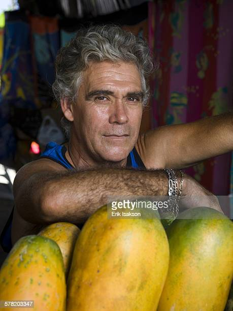 Portrait of a  man with fruit