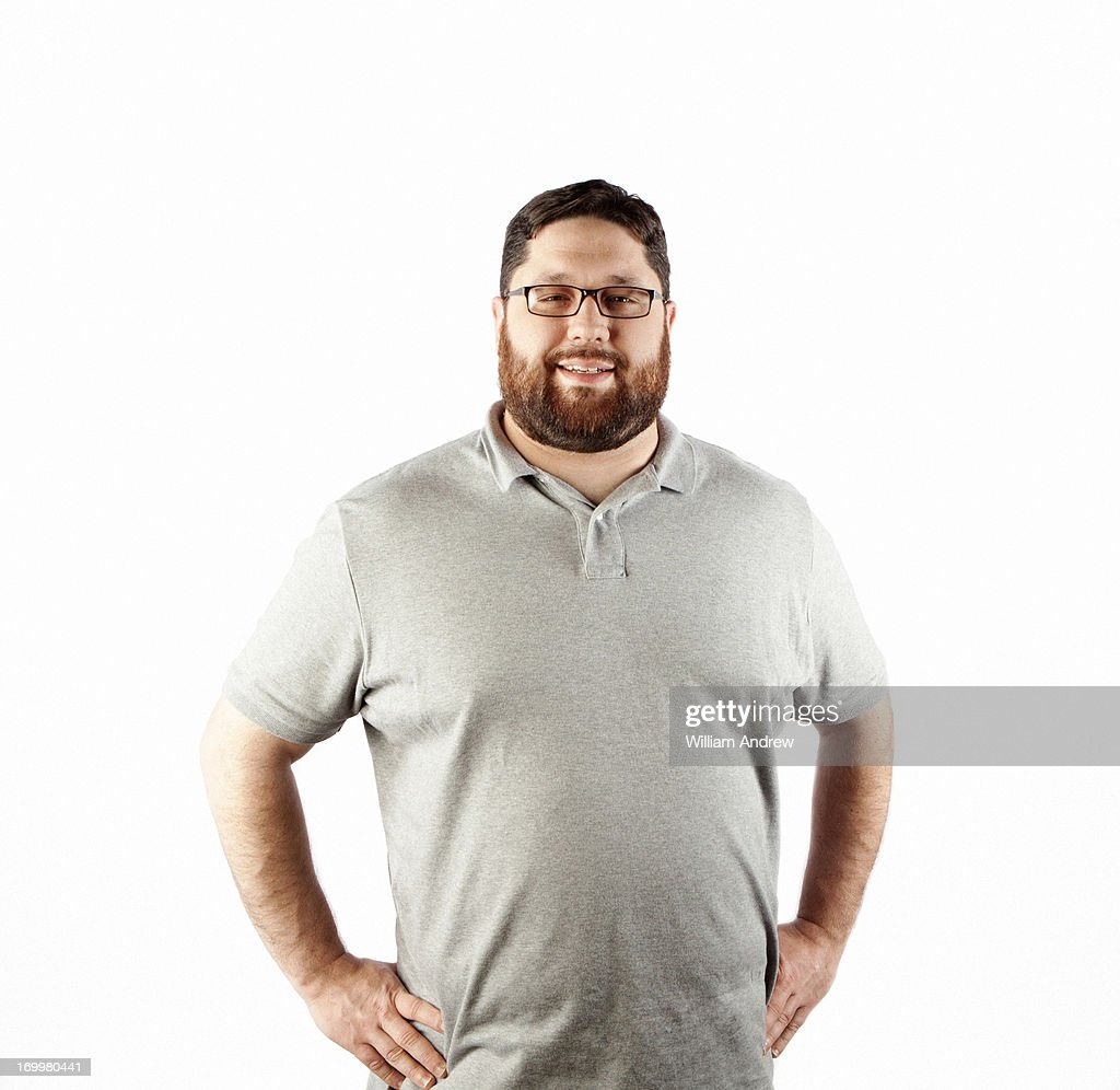 Portrait of a man with hands on hips : Stock Photo