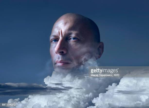 Portrait of a man with head in clouds.