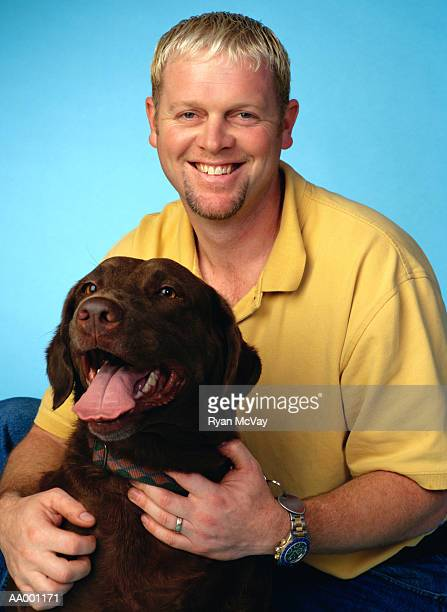 portrait of a man with his dog - goatee stock pictures, royalty-free photos & images