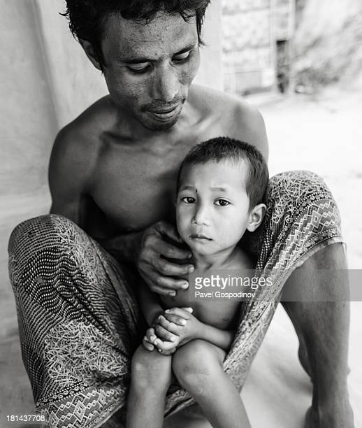 CONTENT] Portrait of a man with his son from Garo tribe Garo Line Para Sreemangal Division of Sylhet Bangladesh Indian SubContinent Asia The Garos...