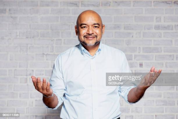 portrait of a man with open arms gesturing welcome - arms outstretched stock pictures, royalty-free photos & images