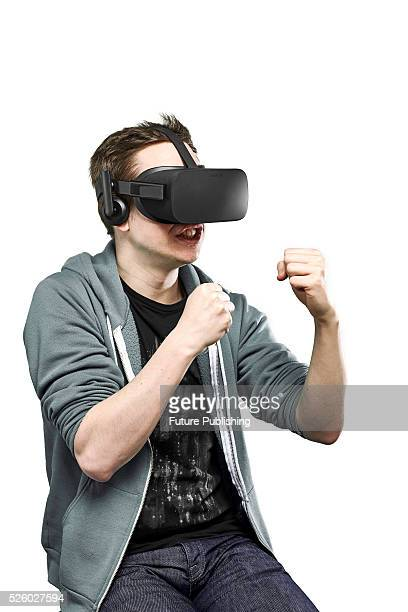 Portrait of a man with raised fists wearing an Oculus Rift virtual reality headset taken on April 13 2016