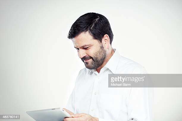 Portrait of a man with tablet