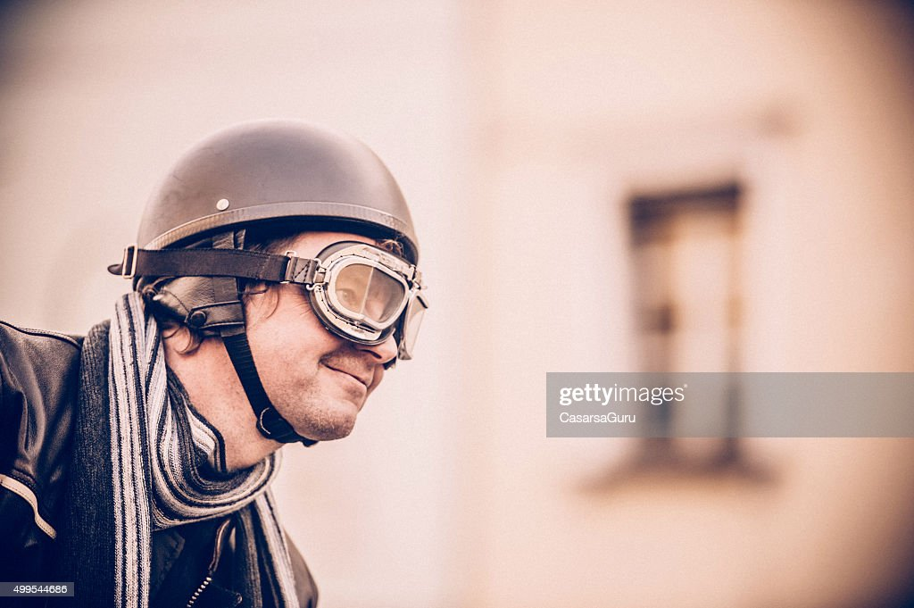 Portrait Of A Man With Vintage Motorcycle Goggles And Helmet High ...