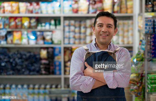 portrait of a man working at a grocery store - store stock pictures, royalty-free photos & images