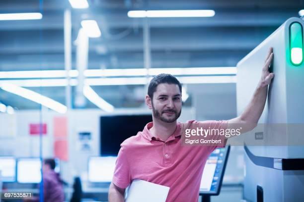 Portrait of a man working in books printing industry, Bremgarten, Hartheim am Rhein, Baden-Wuerttemberg, Germany