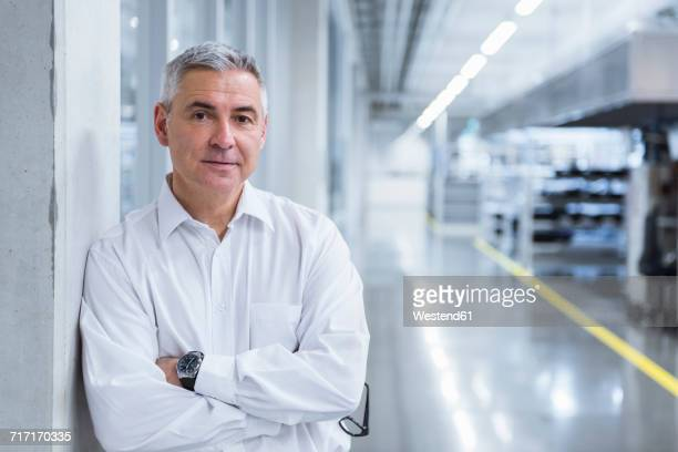 Portrait of a manager on shop floor of a factory