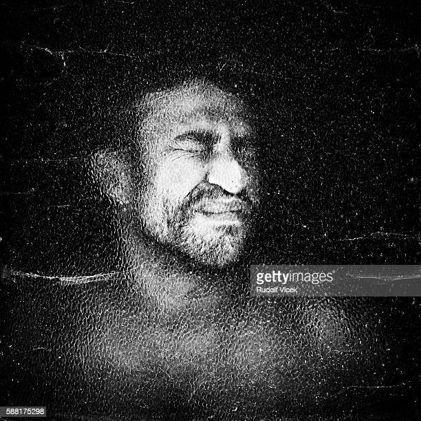 portrait of a man's face squeezed against glass - of deformed people stock pictures, royalty-free photos & images