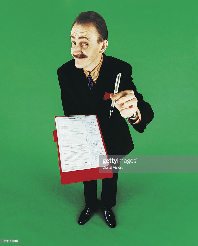 Portrait of a Market Researcher Holding a Fountain Pen and a Questionnaire : Stock Photo