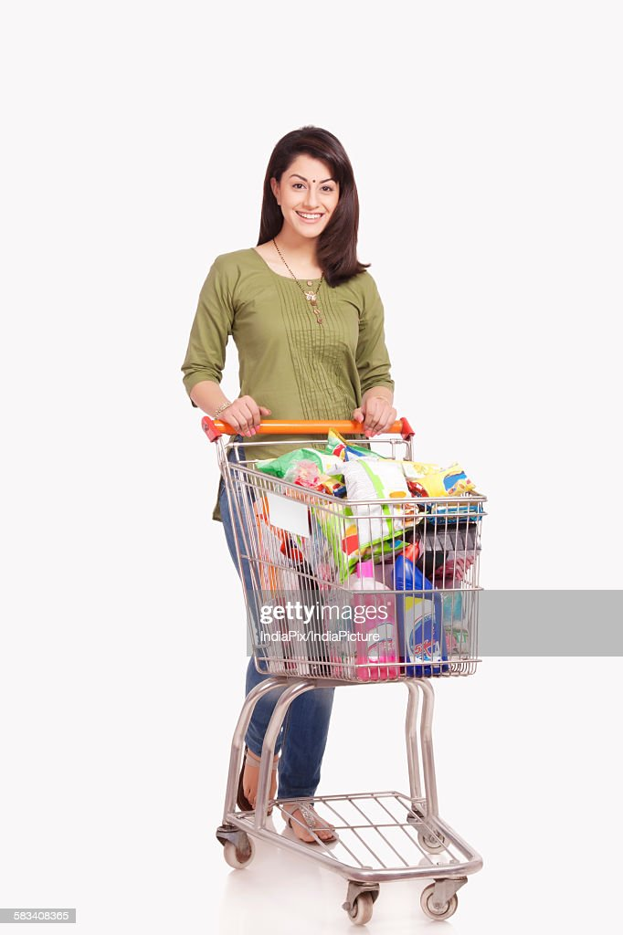 Portrait of a married woman with a shopping cart : Stock Photo