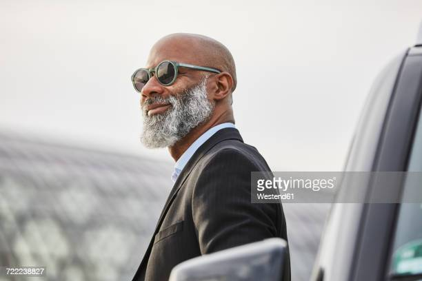 portrait of a mature businessman - best sunglasses for bald men stock pictures, royalty-free photos & images
