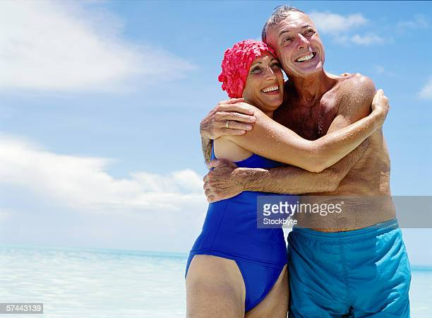 portrait of a mature couple hugging each other at the beach
