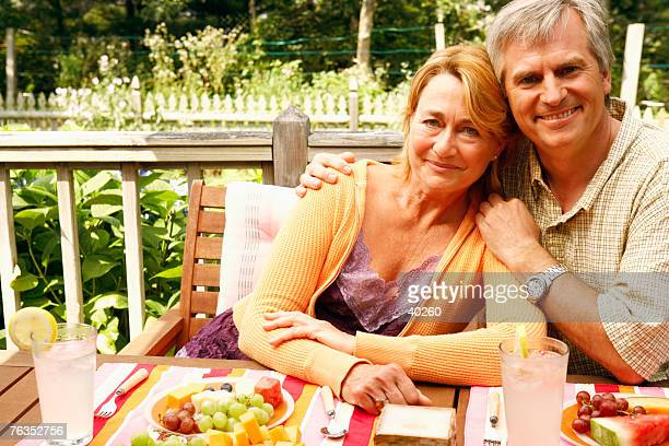 Portrait of a mature couple sitting at the table