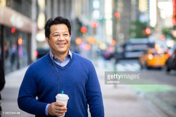 portrait of a mature hispanic businessman in city - handsome native american men stock pictures, royalty-free photos & images