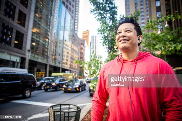 portrait of a mature hispanic man working out in city - handsome native american men stock pictures, royalty-free photos & images