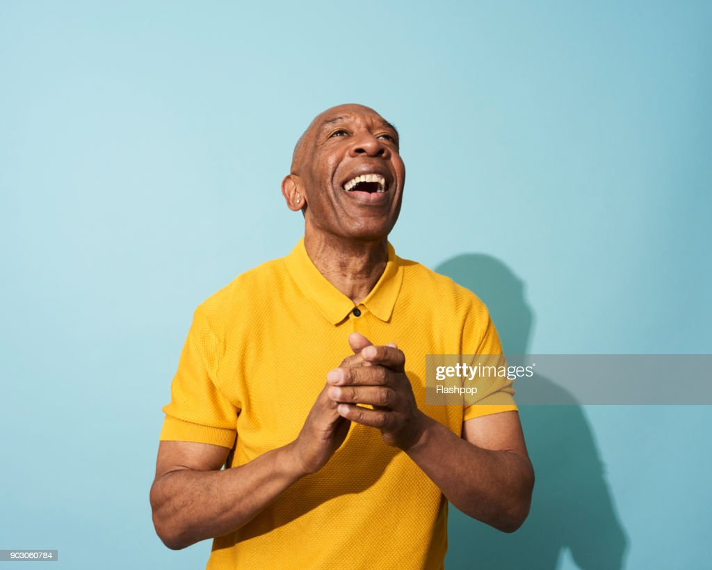 Portrait of a mature man dancing, smiling and having fun : Stock Photo