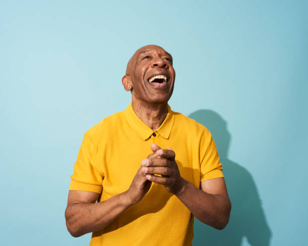 portrait of a mature man dancing, smiling and having fun - 彩色影像 個照片及圖片檔
