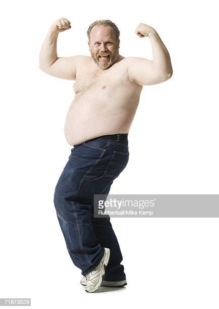 Portrait of a mature man flexing his muscles