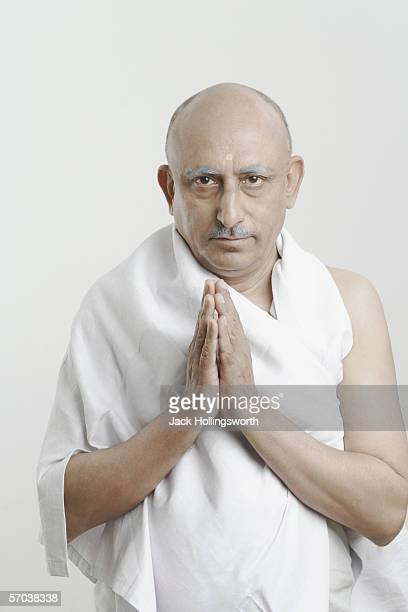 portrait of a mature man in a prayer position - prayer pose greeting bildbanksfoton och bilder
