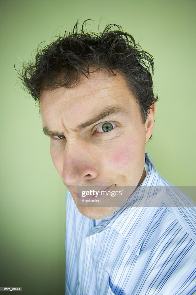 Portrait of a mature man making a face : Foto de stock