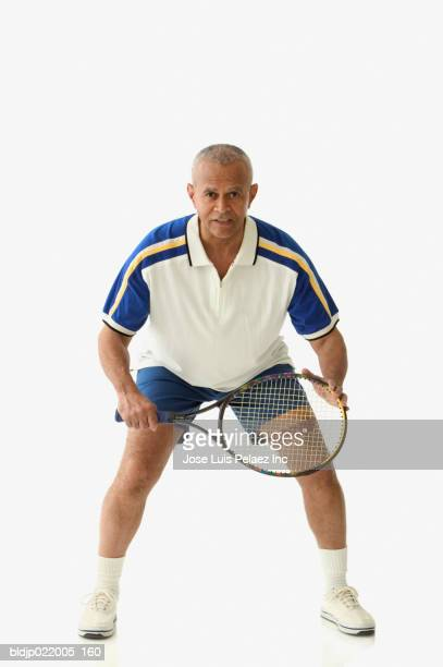 portrait of a mature man playing tennis - black shorts stock pictures, royalty-free photos & images