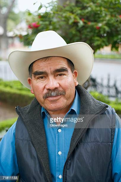Portrait of a mature man wearing a cowboy hat
