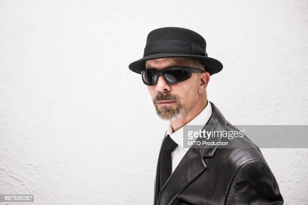 Portrait of a mature man wearing sunglasses and hat, Munich, Bavaria, Germany