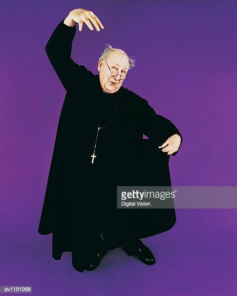 portrait of a mature priest dancing - vicar stock pictures, royalty-free photos & images