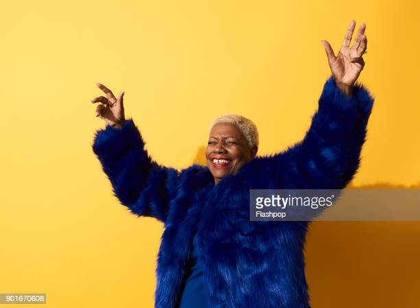 Portrait of a mature woman dancing and laughing
