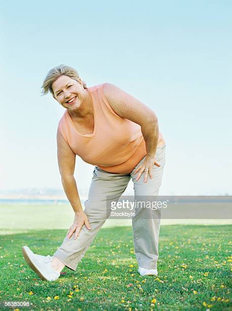 portrait of a mature woman exercising in the park