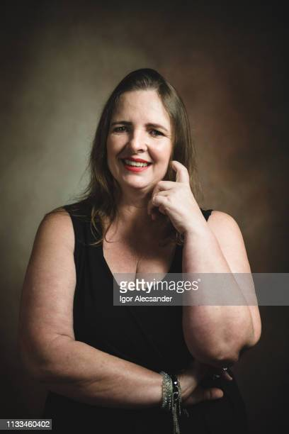 portrait of a mature woman in studio - cellulitis stock photos and pictures