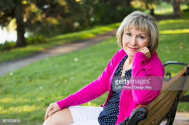 Portrait of a mature woman sitting on a park bench