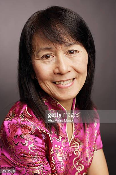 Portrait of a mature woman, smiling at camera
