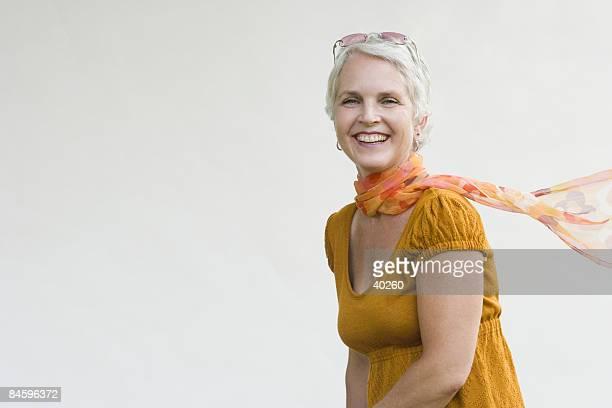 portrait of a mature woman smiling - ネッカチーフ ストックフォトと画像