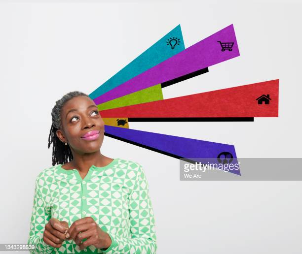 portrait of a mature woman with financial planning graphics surrounding her - one mature woman only stock pictures, royalty-free photos & images