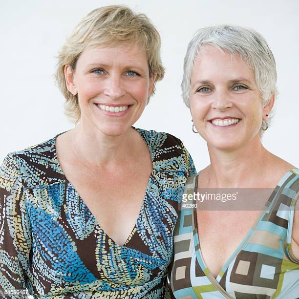 portrait of a mature woman with her sister smiling - endast vuxna bildbanksfoton och bilder