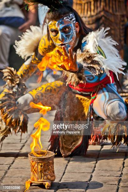 CONTENT] portrait of a Mayan warrior with the body painting playing with fire mexico city mexico
