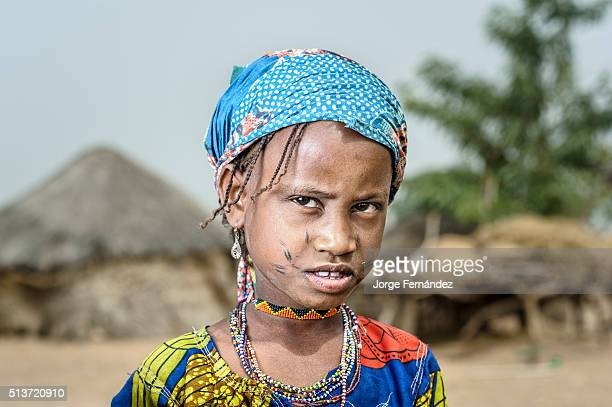 Portrait of a Mbororo girl from Cameroon wearing the beggining of the typical scarifications of this tribe on her face