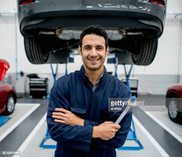 Portrait of a mechanic fixing cars at an auto repair shop