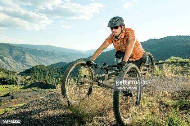 Portrait of a men with differing abilities on a montain bike.