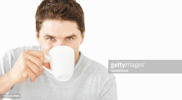 Portrait of a mid adult guy drinking coffee