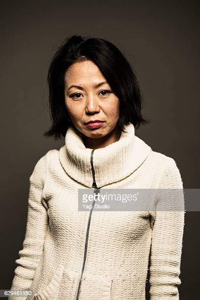 portrait of a mid adult japanese woman - shy stock pictures, royalty-free photos & images