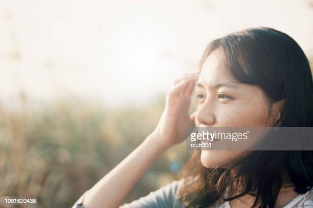 portrait of a mid adult korean woman in her late 20's - mid adult stock pictures, royalty-free photos & images