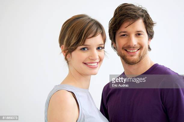 Portrait of a mid adult man and a young woman smiling