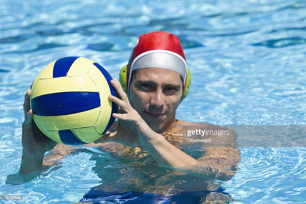 Portrait of a mid adult man playing water polo in a swimming pool : Foto de stock