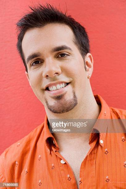 portrait of a mid adult man smiling - goatee stock pictures, royalty-free photos & images