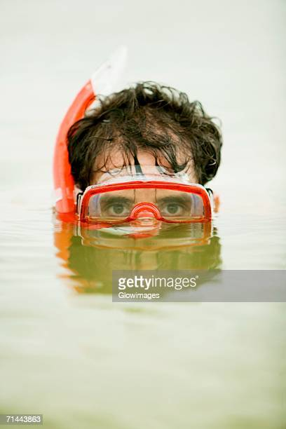 Portrait of a mid adult man wearing a snorkel