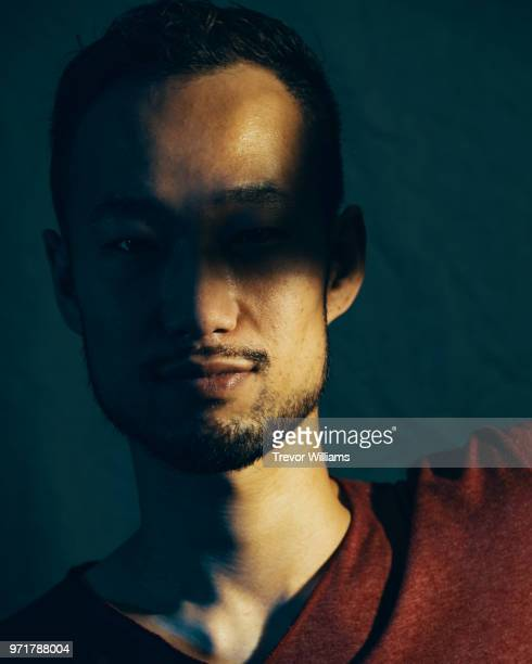 portrait of a mid adult man with shadow over his eyes - only mid adult men stock pictures, royalty-free photos & images