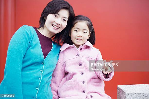 Portrait of a mid adult woman and her daughter